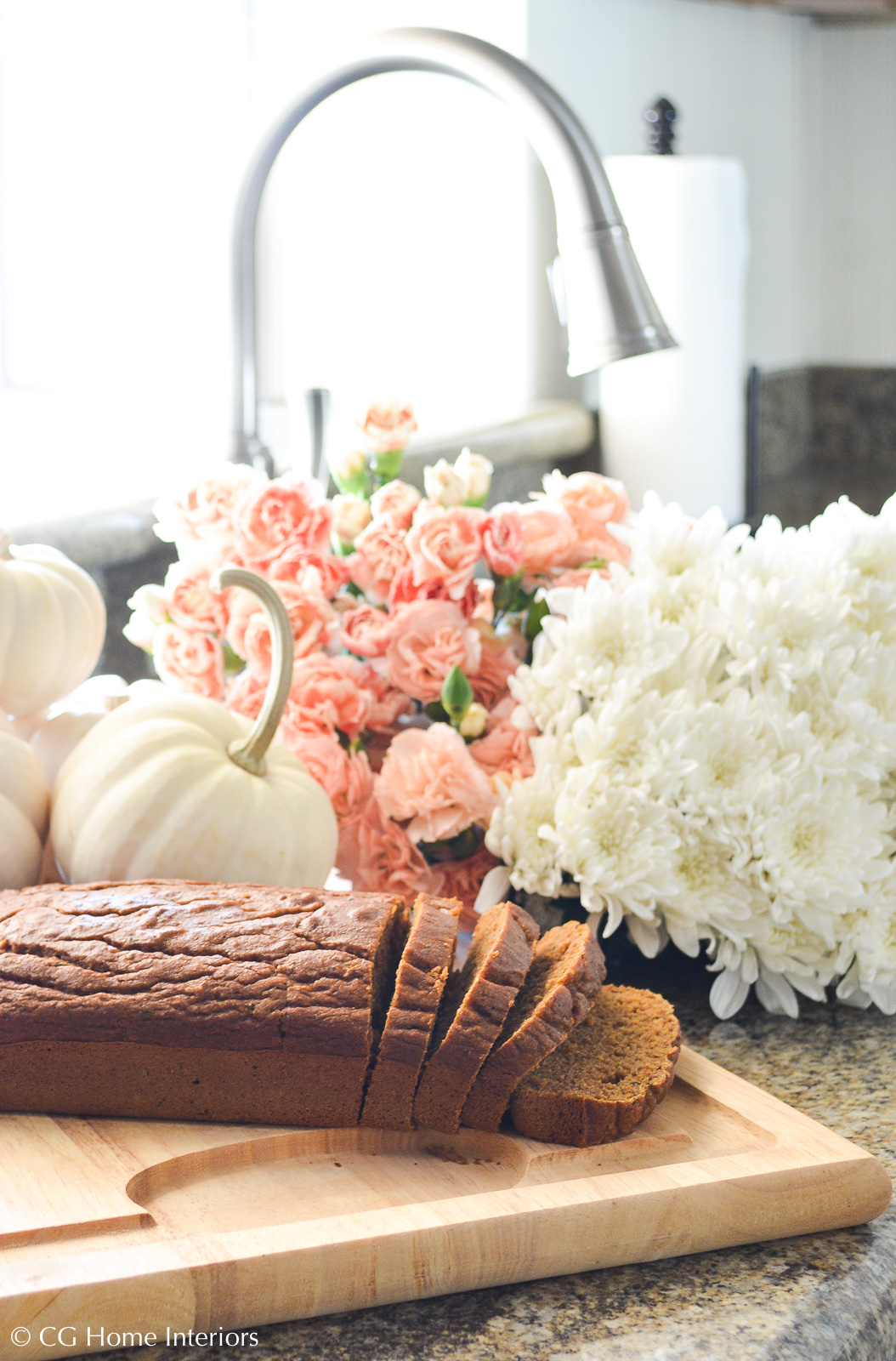 Healthy Pumpkin Zucchini Bread with Fall Flowers and white pumpkins