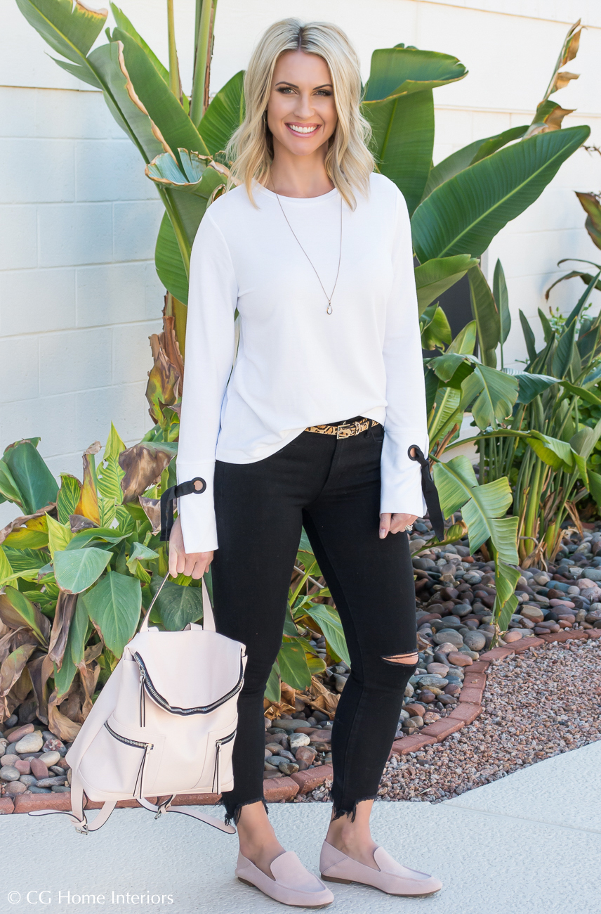 Black jeans, blush handbag, blush shoes